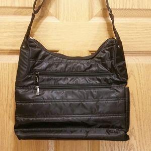 EUC LUG crossbody travel bag with bottle pocket